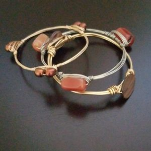 Preowned bangles with genuine stones